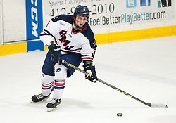 March 11 2016: Robert Morris Colonials defenseman Eric Israel (8) skates with the puck during the first period in game one of the Atlantic Hockey quarterfinals series between the Bentley Falcons and the Robert Morris Colonials at the 84 Lumber Arena in Neville Island, Pennsylvania (Photo by Justin Berl)