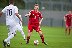NEWPORT, WALES - Thursday, September 25, 2014: Wales' Theo Llewellyn in action against France during the Under-16's International Friendly match at Dragon Park. (Pic by David Rawcliffe/Propaganda)