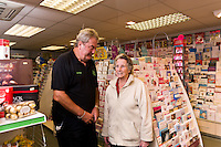 Market Weighton, East Yorkshire. Pictured The Paper Shop's  Lional Cashin chats to customer Mavis Wriglesworth