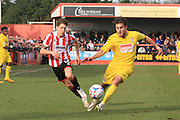 James Rowe and John Goddard during the Vanarama National League match between Cheltenham Town and Woking at Whaddon Road, Cheltenham, England on 12 March 2016. Photo by Antony Thompson.