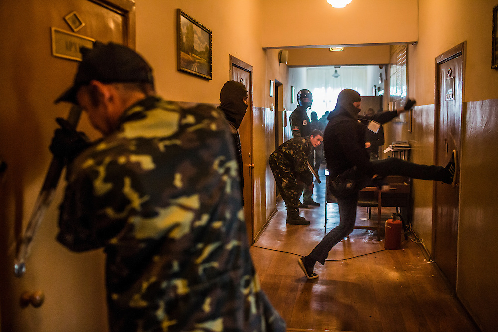 Pro-Russian protesters occupy and ransack the military prosecutor's office on May 4, 2014 in Donetsk, Ukraine. Cities across Eastern Ukraine have been overtaken by pro-Russian protesters in recent weeks, leading the Ukrainian military to respond with force in some areas.
