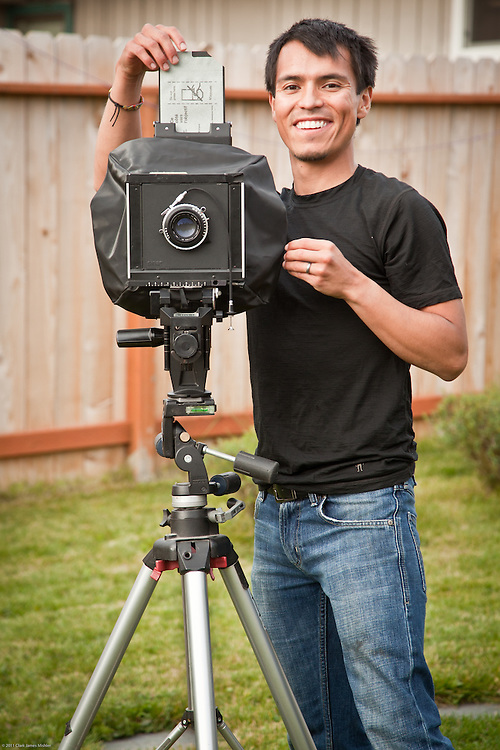 Oscar Avellaneda with his 4X5 view camera in his backyard in East Anchorage