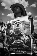 "Chávez supporter holds a poster of the late Venezuelan President during his funeral in Caracas, 8th March 2013. Chávez ruled Venezuela for 14 years, passed away on the 5th March 2013.  He revolutionized not only his nation but also other countries in Latin America, with his political views and what he called the ""21st Century Socialism"", supported by the petrodollars from Venezuela's massive oil-reserves."