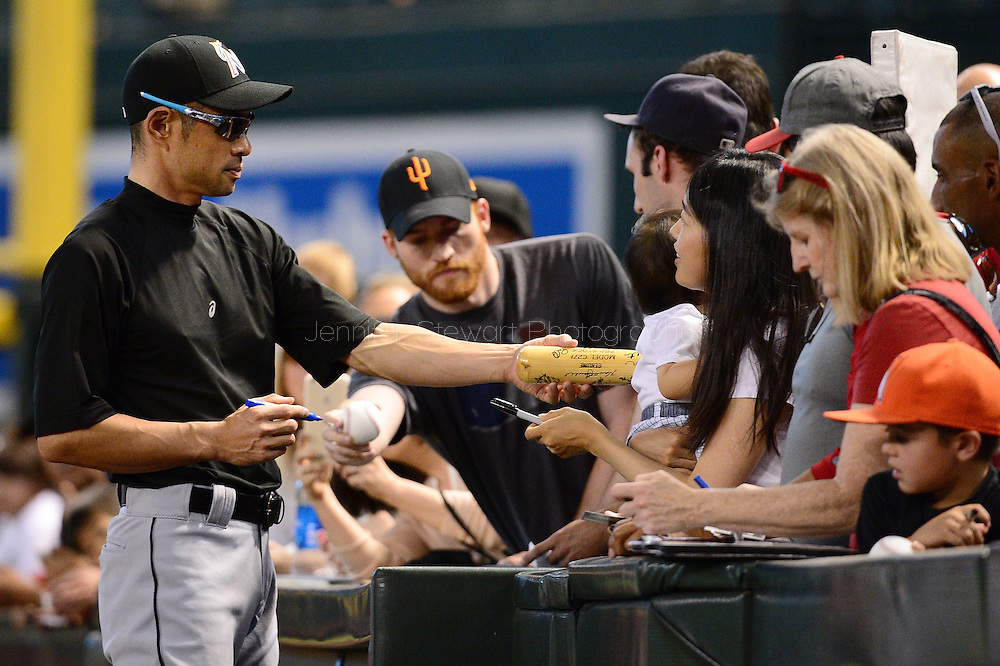 PHOENIX, AZ - JUNE 12:  Ichiro Suzuki #51 of the Miami Marlins signs an autograph for a fan prior to the MLB game against the Arizona Diamondbacks at Chase Field on June 12, 2016 in Phoenix, Arizona.  (Photo by Jennifer Stewart/Getty Images)
