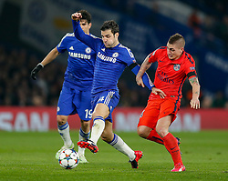 Cesc Fabregas of Chelsea is challenged by Marco Verratti of Paris Saint-Germain - Photo mandatory by-line: Rogan Thomson/JMP - 07966 386802 - 11/03/2015 - SPORT - FOOTBALL - London, England - Stamford Bridge - Chelsea v Paris Saint-Germain - UEFA Champions League Round of 16 Second Leg.