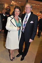 The HON.CHRISTOPHER & MRS GILMOUR at a preview evening of the annual London LAPADA (The Association of Art & Antiques Dealers) antiques Fair held in Berkeley Square, London on 18th September 2012.