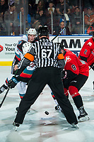 KELOWNA, BC - DECEMBER 30:  Referee Mike Langin drops the puck at center ice between the Kelowna Rockets and the Prince George Cougars at Prospera Place on December 30, 2019 in Kelowna, Canada. (Photo by Marissa Baecker/Shoot the Breeze)