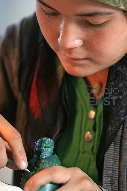 A female worker carves a Jade jewel in Hetian, Xinjiang province, China, on October 13, 2006. The Uyghur people are a Turkic ethnic group living mainly in the Xinjiang Uyghur Autonomous Region of China. Photo by Lucas Schifres/Pictobank