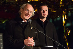 London, UK. 5 November, 2019. John Shipton, Julian Assange's father, accompanied by Julian Assange's cousin Dylan, addresses supporters of the Don't Extradite Assange Campaign assembled outside the Home Office to protest against the extradition of the Wikileaks whistleblower to the United States. Rapper M.I.A. performed at the protest and the other speakers included fashion designer Vivienne Westwood.