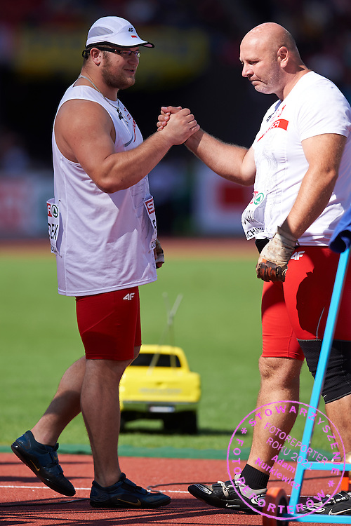 (L) Pawel Fajdek and (R) Szymon Ziolkowski both of Poland while men's hammer throw final during the Fifth Day of the European Athletics Championships Zurich 2014 at Letzigrund Stadium in Zurich, Switzerland.<br /> <br /> Switzerland, Zurich, August 16, 2014<br /> <br /> Picture also available in RAW (NEF) or TIFF format on special request.<br /> <br /> For editorial use only. Any commercial or promotional use requires permission.<br /> <br /> Photo by &copy; Adam Nurkiewicz / Mediasport