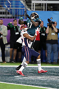 Philadelphia Eagles wide receiver Alshon Jeffery (17) is covered by New England Patriots cornerback Eric Rowe (25) as he leaps and catches a 34 yard first quarter pass touchdown pass good for a 9-3 Eagles lead during the 2018 NFL Super Bowl LII football game against the New England Patriots on Sunday, Feb. 4, 2018 in Minneapolis. The Eagles won the game 41-33. (©Paul Anthony Spinelli)