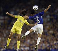 Photo: Aidan Ellis.<br /> Everton v Villarreal. UEFA Champions League Qualifying.<br /> 09/08/2005.<br /> Everton's mikkael Arteta battles in the air with villareal's Jose Verdu