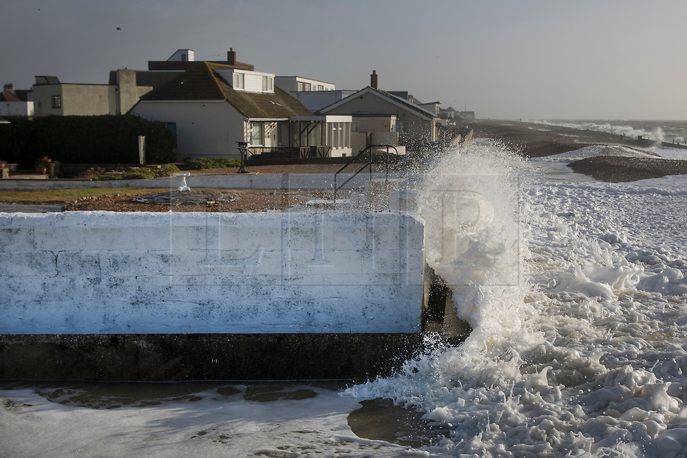© Licensed to London News Pictures. 03/01/2018. Hayling Island, UK. Strong winds bring high waves over the top of sea defences at Hayling Island as Storm Eleanor hits the south. Winds of up to 80 mph are being forecast today in parts of the UK. Photo credit: Peter Macdiarmid/LNP