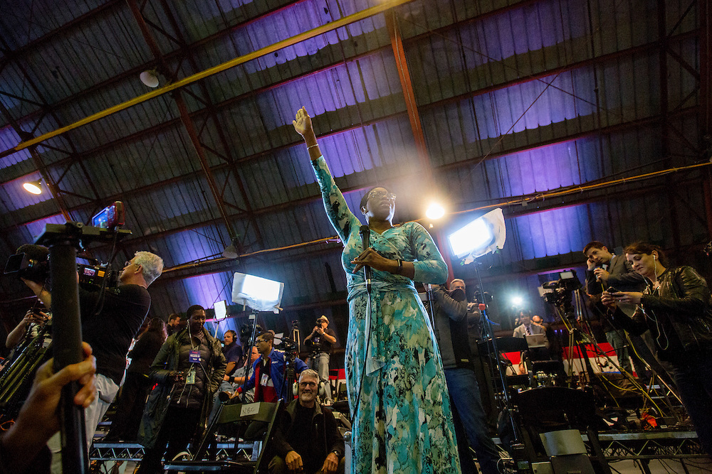 Nina Turner, a former Ohio state senator greets the crowd of supporters who gathered at Barker Hangar to watch the results of the California primary. June 7, 2016. Santa Monica, Calif. (Photo by Gabriel Romero ©2016)