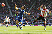 Leicester City forward Shinji Okazaki (20)  feels the challenge during the Barclays Premier League match between Sunderland and Leicester City at the Stadium Of Light, Sunderland, England on 10 April 2016. Photo by Simon Davies.