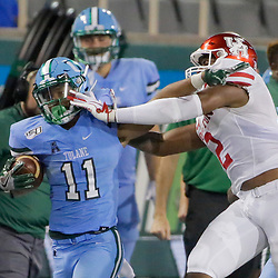 Sep 19, 2019; New Orleans, LA, USA; Tulane Green Wave running back Amare Jones (11) is pushed out of bounds by Houston Cougars safety Deontay Anderson (2) during the fourth quarter at Yulman Stadium. Mandatory Credit: Derick E. Hingle-USA TODAY Sports