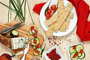 Cheese cracker snack with tomato pesto, danish blue cheese and cucumber
