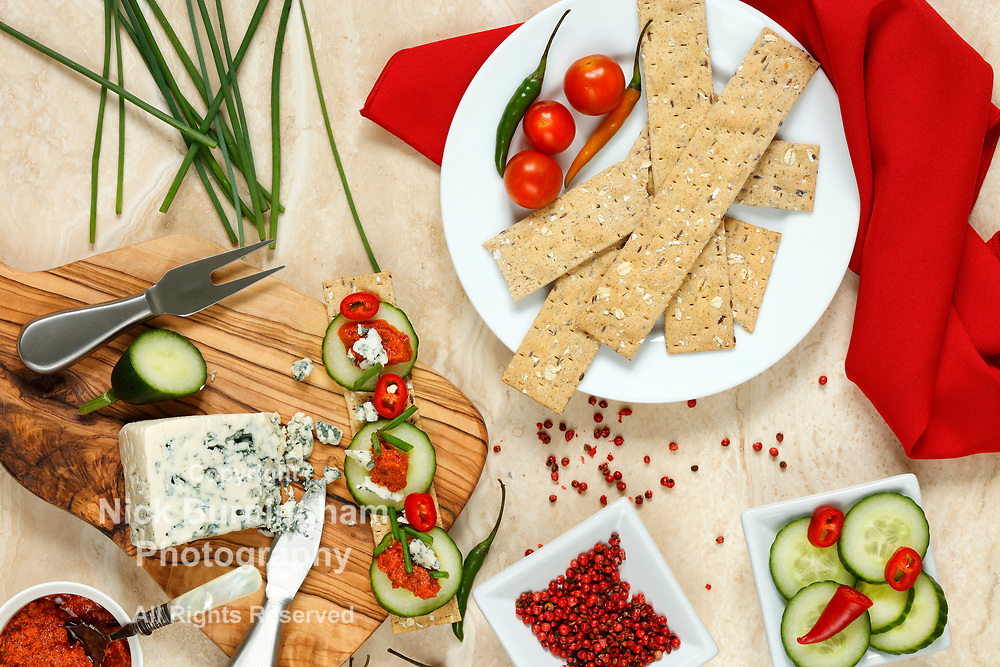 Cheese cracker snack with tomato pesto, danish blue cheese and cucumber