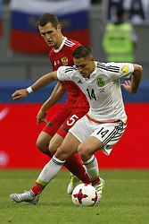 June 24, 2017 - Kazan, Russia - Viktor Vasin (L) of Russia national team and Javier Hernandez of Mexico national team vie for the ball during the Group A - FIFA Confederations Cup Russia 2017 match between Russia and Mexico at Kazan Arena on June 24, 2017 in Kazan, Russia. (Credit Image: © Mike Kireev/NurPhoto via ZUMA Press)