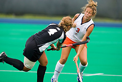 Virginia Cavaliers midfielder Haley Carpenter (3) is hit by the stick of Providence Friars defender Ashley Mulkey (4).  The Virginia Cavaliers field hockey team defeated the Providence College Friars on the University Hall Turf Field on the Grounds of the University of Virginia in Charlottesville, VA on August 31, 2008.
