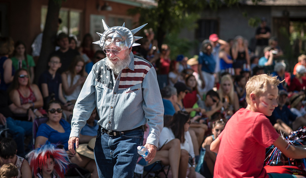 rer070417h/metro/July 04, 2017/Albuquerque Journal<br /> Mel Alper(Cq) of Corrales, New Mexico dons a patriotic Statue of Liberty mask along with an American flag denim shirt as he walks the 4th of July parade route through the town of Corrales Tuesday morning. <br /> Albuquerque, New Mexico Roberto E. Rosales/Albuquerque Journal