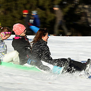 Girls hang on to their sleds while sledding in Central Park after New York City was hit with over 7 inches of snow during its first winter storm of the year. Central Park, Manhattan, New York, USA. 4th January 2014 Photo Tim Clayton