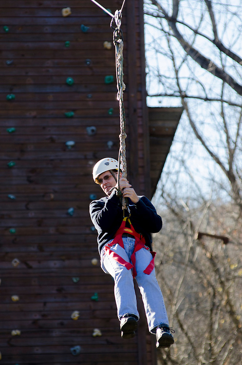 Mark Brown rides the zipline during Ohio University's Dad's Weekend.