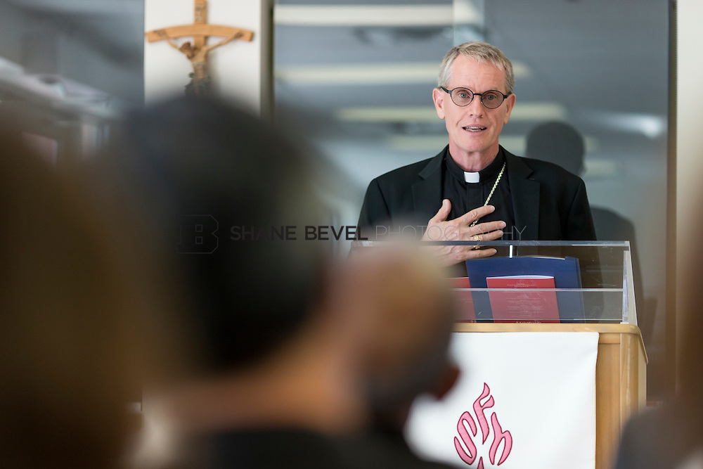 9/29/16 4:07:41 PM --  Bishop David Konderla blesses the newly remodeled Xavier Clinic in east Tulsa. <br /> <br /> Photo by Shane Bevel