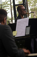 """The 12th annual Hyde Park Jazz Festival was held this weekend, Saturday, September 29th and Sunday, September 30th, 2018 at various venues around Hyde Park. Jazz musicians from all around came out to play at the two-day event. <br /> <br /> 2967, 2972, 2986, 2987 - Isaiah Collier and the Chosen Few played the Wagner Stage Saturday afternoon on the Midway Plaisance located at 1130 Midway Plaisance on the University of Chicago campus.<br /> <br /> Please 'Like' """"Spencer Bibbs Photography"""" on Facebook.<br /> <br /> Please leave a review for Spencer Bibbs Photography on Yelp.<br /> <br /> Please check me out on Twitter under Spencer Bibbs Photography.<br /> <br /> All rights to this photo are owned by Spencer Bibbs of Spencer Bibbs Photography and may only be used in any way shape or form, whole or in part with written permission by the owner of the photo, Spencer Bibbs.<br /> <br /> For all of your photography needs, please contact Spencer Bibbs at 773-895-4744. I can also be reached in the following ways:<br /> <br /> Website – www.spbdigitalconcepts.photoshelter.com<br /> <br /> Text - Text """"Spencer Bibbs"""" to 72727<br /> <br /> Email – spencerbibbsphotography@yahoo.com<br /> <br /> #SpencerBibbsPhotography #HydePark #Community #Neighborhood<br /> #Music<br /> #HydeParkJazzFestival<br /> #Jazz<br /> #LiveMusic<br /> #IsaiahCollier"""