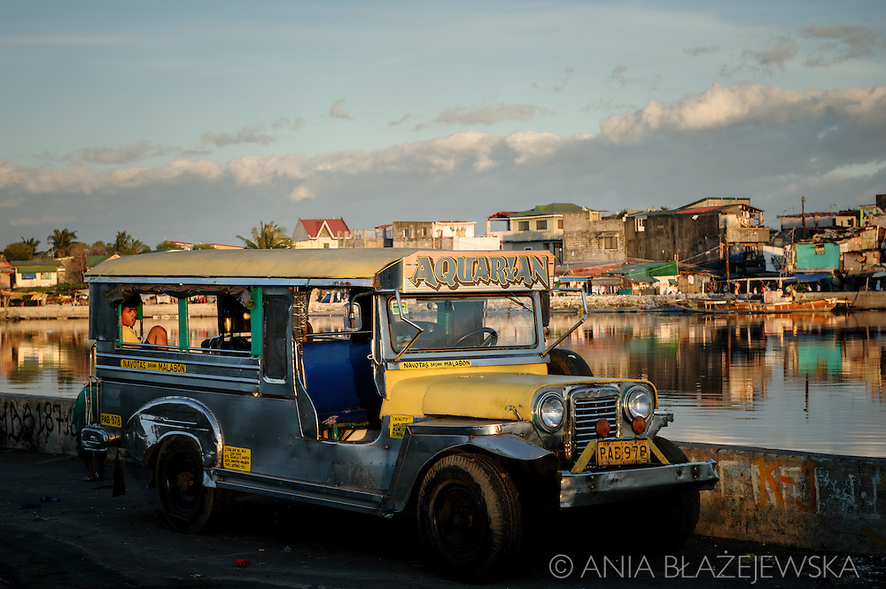 Philippines, Metro Manila. Late afternoon in Navotas. Jeepney, the popular public transportation, left at the water.