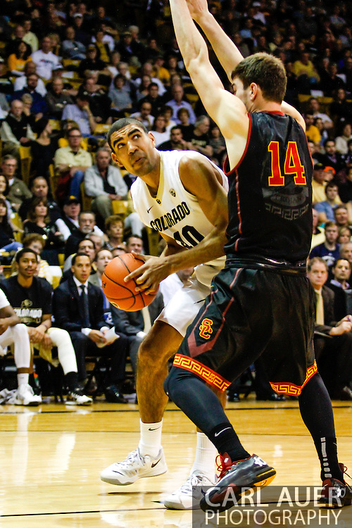 January 18th, 2014:  Colorado Buffaloes sophomore forward Josh Scott (40) looks to get past USC Trojans sophomore forward Strahinja Gavrilovic (14) in second half action of the NCAA Basketball game between the USC Trojans and the University of Colorado Buffaloes at the Coors Events Center in Boulder, Colorado