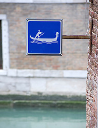 Sign beside canal showing that it is open to gondolas in Venice Italy