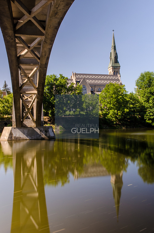 St. Georges Street and the Heffernan Street footbridge, with a reflection on the Speed River, downtown Guelph.