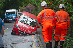 ©Licensed to London News Pictures 16/09/2019.<br /> Chislehurst ,UK. A car driven in to a hole on Yester Road, Chislehurst, South East London this morning. The hole, which was was dug by Thames water workmen, had no barrier around around it, according to the driver. . Photo credit: Grant Falvey/LNP
