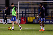 AFC Wimbledon midfielder Anthony Wordsworth (40) and AFC Wimbledon defender Paul Kalambayi (30) warming up during the EFL Trophy group stage match between AFC Wimbledon and Stevenage at the Cherry Red Records Stadium, Kingston, England on 6 November 2018.