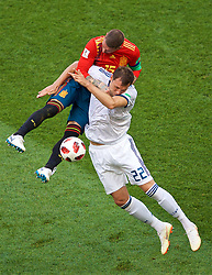 MOSCOW, RUSSIA - Sunday, July 1, 2018: Spain's Sergio Ramos grabs hold of Russia's Artem Dzyuba as he challenges for a header during the FIFA World Cup Russia 2018 Round of 16 match between Spain and Russia at the Luzhniki Stadium. (Pic by David Rawcliffe/Propaganda)