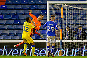 AFC Wimbledon goalkeeper George Long (1), on loan from Sheffield United, saves and tips the ball over the bar during the EFL Sky Bet League 1 match between Oldham Athletic and AFC Wimbledon at Boundary Park, Oldham, England on 21 November 2017. Photo by Simon Davies.