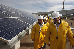 October 5, 2018 - Kiev, Ukraine - Visitors walk past solar panels of the first solar power plant 'Solar Chernobyl' located in front of the New Safe Confinement arch covering the damaged fourth reactor of the Chernobyl nuclear power plant, during an opening ceremony in Chernobyl Nuclear Power Plant. (Credit Image: © Serg Glovny/ZUMA Wire)