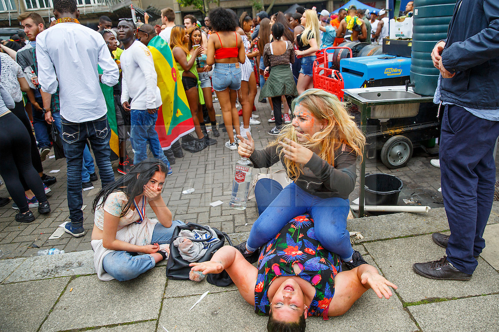 © Licensed to London News Pictures. 30/08/2015. London, UK. Revellers enjoying themselves at Notting Hill Carnival in west London on family day, Sunday, August 30, 2015. Photo credit: Tolga Akmen/LNP
