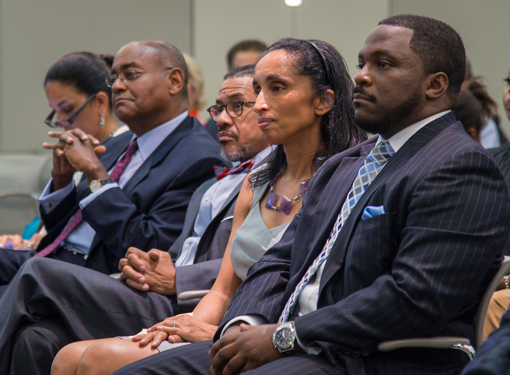 Alison Leland listens to comments during a meeting of the Houston ISD Board of Trustees meeting, September 11, 2014.