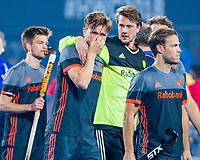 BHUBANESWAR, INDIA -  Teleurstelling Jorrit Croon (Ned) en keeper Sam van der Ven (Ned) , Jeroen Hertzberger (Ned) en links Thierry Brinkman (Ned)  na de verloren shoot outs na  de  finale tussen België en Nederland (0-0)  bij het WK Hockey heren in het Kalinga Stadion. Belgie wint de shoot outs.  COPYRIGHT KOEN SUYK