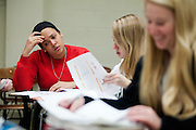 Jenea Elder (left) looks over a worksheet during a supplemental instruction session in Morton Hall. Also pictured are Dana Fick (center) and Kathrine Worrobnick (right). Photo by: Ross Brinkerhoff.
