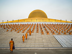 February 11, 2017 - Khlong Luang, Pathum Thani, Thailand - Buddhist monks walk to their seat during the Makha Bucha Day service at Wat Phra Dhammakaya.  Makha Bucha Day is a public holiday in Cambodia, Laos, Myanmar and Thailand. Many people go to the temple to perform merit-making activities on Makha Bucha Day, which marks four important events in Buddhism: 1,250 disciples came to see the Buddha without being summoned, all of them were Arhantas, or Enlightened Ones, and all were ordained by the Buddha himself. (Credit Image: © Jack Kurtz via ZUMA Wire)