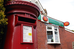 Postbox outside post office,