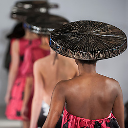© Licensed to London News Pictures. 21/02/2015. Grand Connaught Rooms, Covent Garden, London, UK.  Models wear elaborate hats and beak face masks as they present a look at the Vietinio AW15 collection at the Grand Connaught Rooms during London Fashion Week's Off Schedule Show. Photo credit : Stephen Chung/LNP