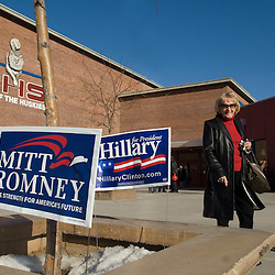 Republican caucus goers pass signs for GOP candidate Mitt Romney and Democratic candidate Hillary Clinton as they leave their precinct's presidential caucus at Reno High School in Reno, Saturday, Jan. 19, 2008...Photo by David Calvert/Bloomberg News