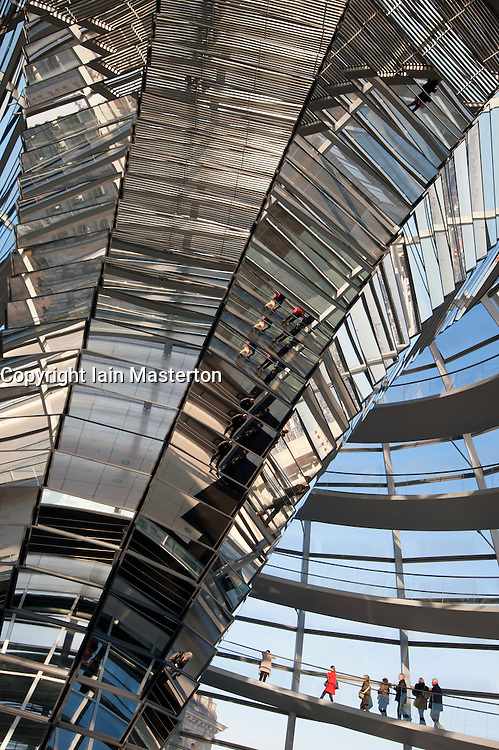 View of the glass dome above debating chamber at the Reichstag in Berlin Germany; Architect Norman Foster