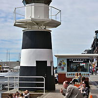Lighthouse Along Strandon at Aker Brygge in Oslo, Norway <br />