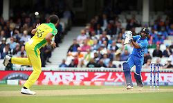 India's Shikhar Dhawan hits a boundary past Australia's Mitchell Starc during the ICC Cricket World Cup group stage match at The Oval, London.