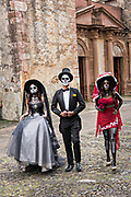 Mexican teens dressed in La Calavera Catrina and Dapper Skeleton costumes for the Day of the Dead or Día de Muertos festival October 31, 2017 in Patzcuaro, Michoacan, Mexico. The festival has been celebrated since the Aztec empire celebrates ancestors and deceased loved ones.